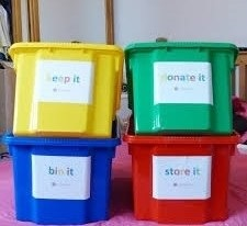 Coloured storage bins can be a great visual tool to aide the organising of any items no longer required.