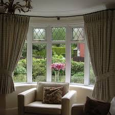 Jms Home Staging Bay window example of a shorter length curtain